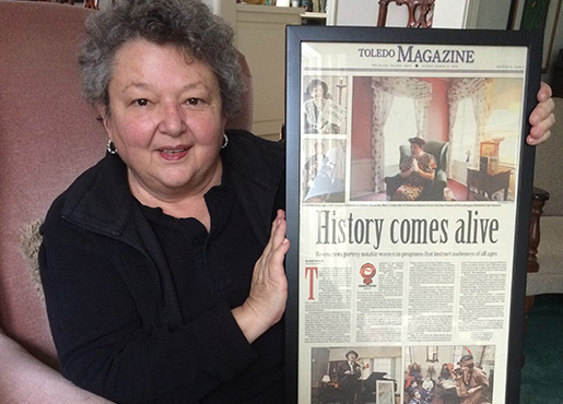 Gail Conrad with a newspaper clipping of her performance as Eleanor Roosevelt.