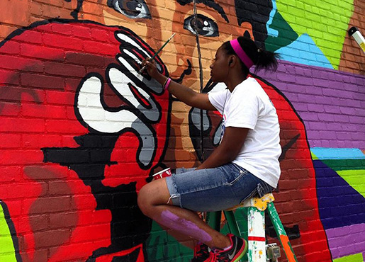 Young Artist Painting Mural