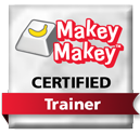 white computer button with red and yellow makeymakey logo